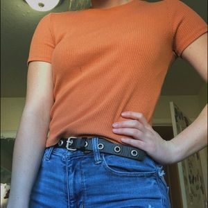 Tight orange shirt